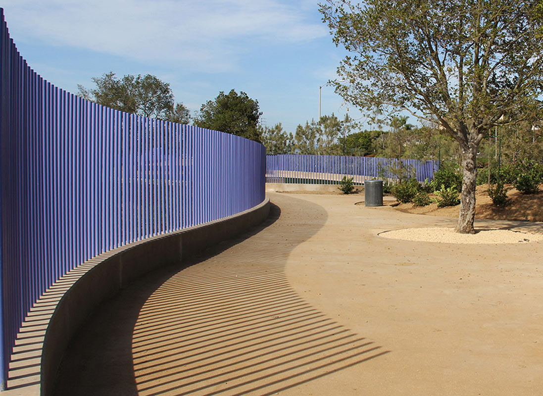 From within the dog park, the pipe rail fence becomes an element of utility � it keeps dogs inside from getting out